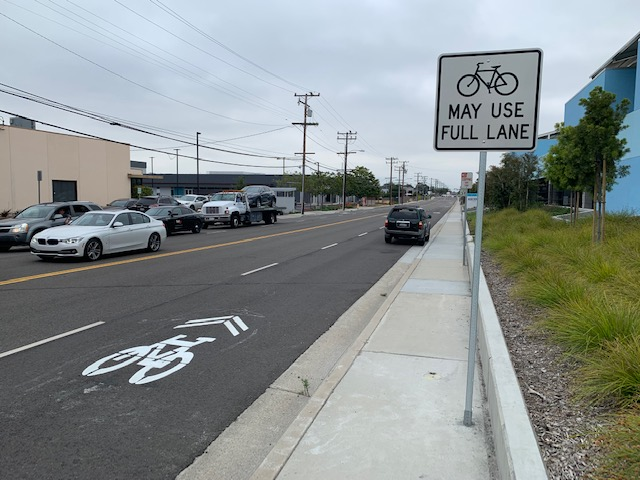 New bikeway sign and pavement marking